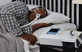A patient wearing CPAP device